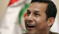 Peru's opposition leader and ex-army officer Humala smiles during interview with Reuters in Lima