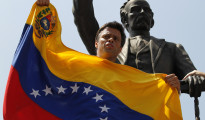Venezuelan opposition leader Leopoldo Lopez speaks to supporters before handing himself over in Caracas