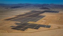 Solar panels are seen in this aerial photograph of First Solar Inc.'s Desert Sunlight Solar Farm in Mojave Desert, California, U.S., on Friday, April 5, 2013. First Solar Inc., the largest thin-film panel manufacturer, sees ?significant growth? in renewable energy projects being developed in the Middle East and North Africa by the end of 2014. Photographer: Tim Rue/Bloomberg