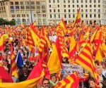 Anti-independentist Catalans hold Catalan and Spanish flags during a